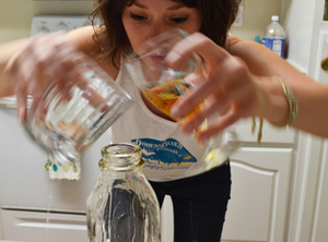 Making hooch is messy business without a funnel. And it tastes terrible. WHOSE IDEA WAS THIS?